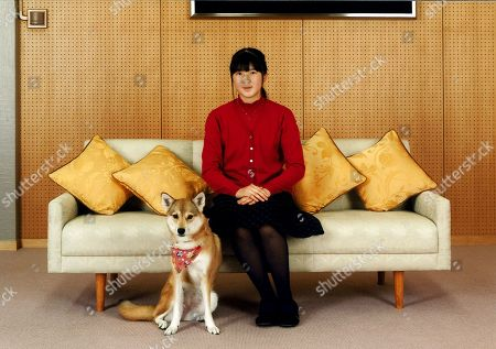 Released by Imperial Household Agency of Japan, Japanese Princess Aiko pose for a photo with her pet dog Yuri at her residence in Tokyo. Princess Aiko, daughter of Crown Prince Naruhito and Crown Princess Masako, celebrated her 14th birthday on Tuesday, Dec. 1