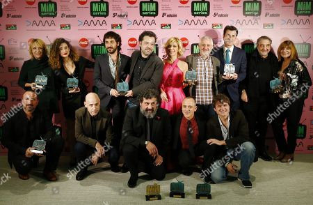 Winners of the MIM Awards (L-R, back row) Blanca Portillo, Maria Pedraza, Alex Rodrigo, Jesus Colmenar, Eva Isanta (C to R, first row) Paco Tous, Javier Gutierrez and Salva Reina, amongst others not identified, pose with their awards after the MIM 2017 Award ceremony in Madrid, Spain, 18 December 2017 (issued 19 December 2017). The awards are for the best TV series of 2017.