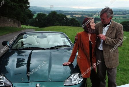 Stock Image of Ep 2412 Tuesday 8th September 1998  Lord Michael stuns Lady Tara by giving her a brand new Jaguar as a present for when she gets her license back. Then he takes her breath away with a huge, sparkling diamond engagement ring - With Lady Tara Oakwell, as played by Anna Brecon and Lord Michael Thornfield, as played by Malcolm Stoddard.