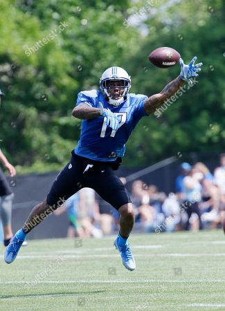 Stock Picture of Detroit Lions wide receiver Andre Caldwell reaches out to catch a pass during NFL football training camp, in Allen Park, Mich