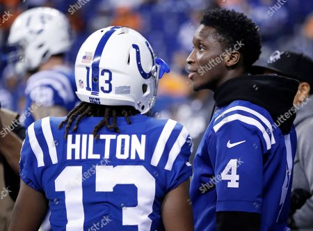 Victor Oladipo, T.Y. Hilton. Indiana Pacers guard Victor Oladipo on the sidelines with Indianapolis Colts T.Y. Hilton (13) before an NFL football game between the Indianapolis Colts and the Denver Broncos in Indianapolis, . The Broncos defeated the Colts 25-13