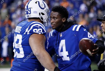 Victor Oladipo, Al Woods. Indiana Pacers guard Victor Oladipo on the sidelines with Indianapolis Colts Al Woods (99) before an NFL football game between the Indianapolis Colts and the Denver Broncos in Indianapolis, . The Broncos defeated the Colts 25-13