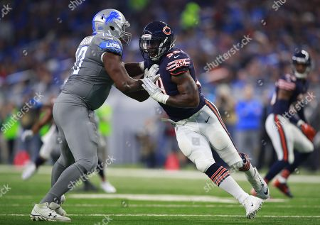 Lamarr Houston, Corey Robinson. Chicago Bears linebacker Lamarr Houston (99) rushes in against Detroit Lions offensive tackle Corey Robinson (70)during an NFL football game in Detroit, . The Lions defeated the Bears 20-10
