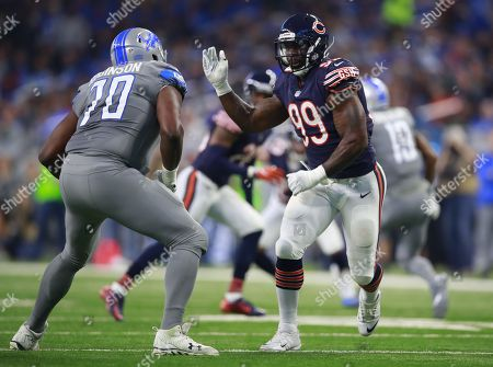 Stock Photo of Lamarr Houston, Corey Robinson. Chicago Bears linebacker Lamarr Houston (99) rushes in against Detroit Lions offensive tackle Corey Robinson (70)during an NFL football game in Detroit, . The Lions defeated the Bears 20-10