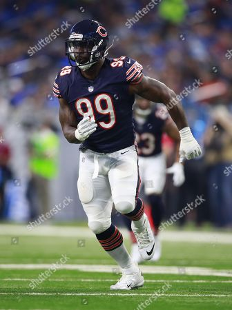 Chicago Bears linebacker Lamarr Houston (99) lines up against the Detroit Lions during an NFL football game in Detroit, . The Lions defeated the Bears 20-10