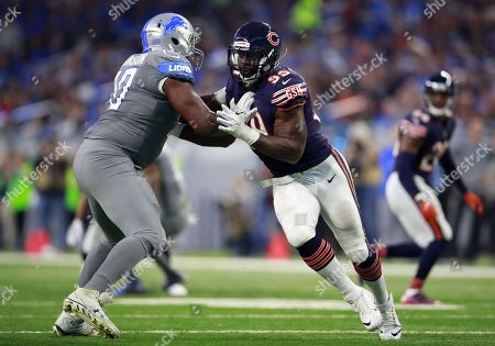 Stock Picture of Lamarr Houston, Corey Robinson. Chicago Bears linebacker Lamarr Houston (99) rushes in against Detroit Lions offensive tackle Corey Robinson (70)during an NFL football game in Detroit, . The Lions defeated the Bears 20-10