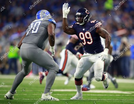 Stock Image of Lamarr Houston, Corey Robinson. Chicago Bears linebacker Lamarr Houston (99) rushes in against Detroit Lions offensive tackle Corey Robinson (70)during an NFL football game in Detroit, . The Lions defeated the Bears 20-10
