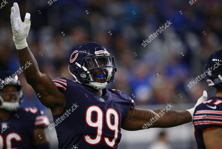 Chicago Bears linebacker Lamarr Houston (99) reacts to a play against the Detroit Lions during an NFL football game in Detroit, . The Lions defeated the Bears 20-10