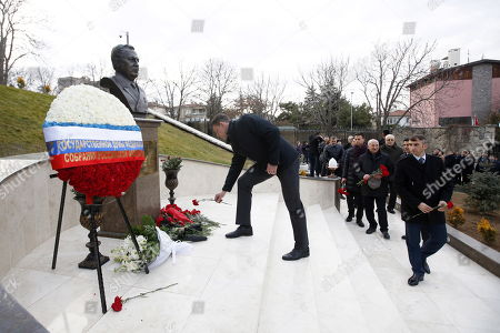 People attend a ceremony for mark the first death anniversary of the Russian ambassador to Turkey, Andrey Karlov in Ankara, Turkey, 19 December 2017.  Russia's ambassador to Turkey, Karlov was assasinated on 19 December during a culutural event at an art gallery in the Turkish capital by Turkish policeman Mevlut Mert Altintas, 22, who had been serving in Ankara's riot police for two years.