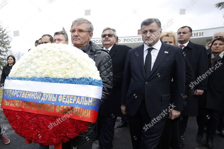 Stock Image of Russian ambassador to Turkey, Aleksey Yerhov (C) attends a ceremony for mark the first death anniversary of the Russian ambassador to Turkey, Andrey Karlov in Ankara, Turkey, 19 December 2017.  Russia's ambassador to Turkey, Karlov was assasinated on 19 December during a culutural event at an art gallery in the Turkish capital by Turkish policeman Mevlut Mert Altintas, 22, who had been serving in Ankara's riot police for two years.
