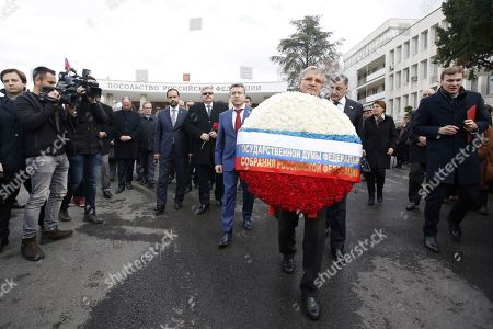 Russian ambassador to Turkey, Aleksey Yerhov (6-R)attends a ceremony for mark the first death anniversary of the Russian ambassador to Turkey, Andrey Karlov in Ankara, Turkey, 19 December 2017.  Russia's ambassador to Turkey, Karlov was assasinated on 19 December during a culutural event at an art gallery in the Turkish capital by Turkish policeman Mevlut Mert Altintas, 22, who had been serving in Ankara's riot police for two years.