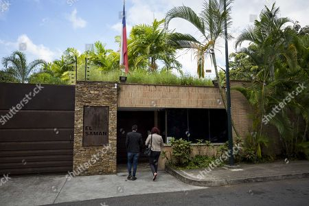National Assembly Deputy Tamara Adrian (R) enters the residency of Chile's ambassador, in Caracas, Venezuela, 19 Decemeber 2017. A commission of the National Assembly of Venezuela (AN, Parliament) noted the good health of Freddy Guevara and Roberto Enriquez, the two opposition politicians who have been staying for weeks in the residence of the Chilean ambassador in the Caribbean country.