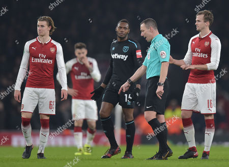 Referee Kevin Friend talks with Diafra Sakho of West Ham United