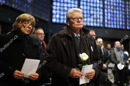 Former German president Joachim Gauck (R) and his partner Daniela Schadt (L) attend a commemorative service on the first anniversary of the terrorist attack on Berlin Christmas market at the Kaiser-Wilhelm-Gedaechtniskirche (Kaiser Wilhelm Memorial Church) in Berlin, Germany, 19 December 2017. On 19 December 2016, Breitscheidplatz square in Berlin was the target of a terror attack in which 12 people lost their lives, when a truck driven by Anis Amri plowed through the Christmas market near the Kaiser-Wilhelm-Gedaechtniskirche.