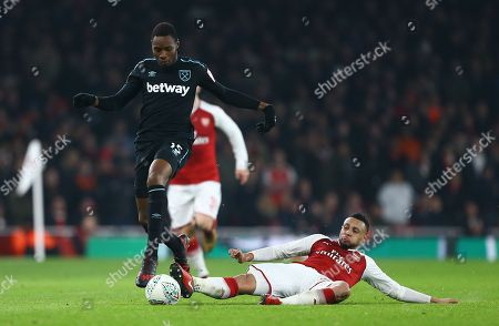 Diafra Sakho of West Ham United controls the ball under pressure from under pressure from  Francis Coquelin of Arsenal