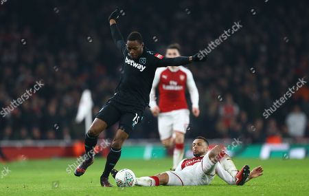 Diafra Sakho of West Ham United controls the ball under pressure from  Francis Coquelin of Arsenal