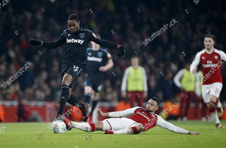Diafra Sakho of West Ham United is tackled by Francis Coquelin of Arsenal