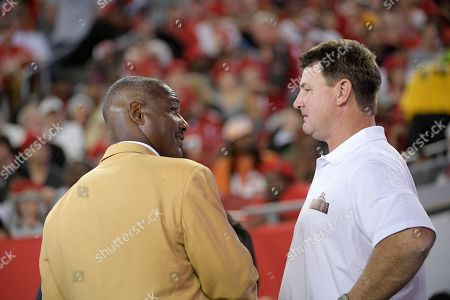 Derrick Brooks, Brad Johnson. Former Tampa Bay Buccaneers linebacker Derrick Brooks, left, talks with former quarterback Brad Johnson on the field during the first half of an NFL football game against the Atlanta Falcons, in Tampa, Fla
