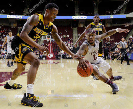 Lavone Holland II, Duane Wilson. Texas A&M guard Duane Wilson (13) dives for a loose ball as Northern Kentucky guard Lavone Holland II (30) reaches in during the first half of an NCAA college basketball game, in College Station, Texas