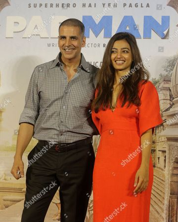 Akshay Kumar, Radhika Apte. Bollywood actor Akshay Kumar, left, with Radhika Apte pose for the media during the song launch of their film Pad Man in Mumbai, India, . The film is inspired from the life of a Tamil Nadu based social activist, Arunachalam Muruganantham who revolutionized the concept of menstrual hygiene in rural India by creating a low-cost sanitary napkins machine. It will be will be released on Jan. 26, 2018