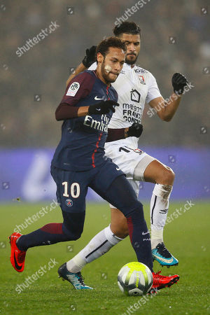 PSG's Neymar, left, challenges for the ball with Caen's Youssef Ait Bennasser during the French League One soccer match between Paris Saint Germain and Caen, at the Parc des Princes stadium in Paris, France