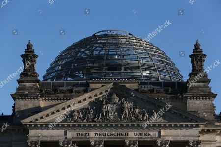 "Reichstag - detail of the inscription ""Dem Deutschen Volke"", ""[To] the German people"", and the Norman Foster designed glass dome."