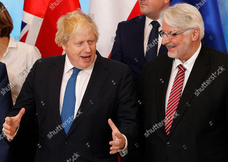 Boris Johnson, Witold Waszczykowski. Britain's Foreign Secretary Boris Johnson and Poland's Foreign Minister Witold Waszczykowski talk before posing for a family photo during Britain's Prime Minister's visit to Poland at the Chancellery of the Prime Minister in Warsaw, Poland