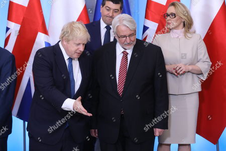 Polish Minister of Foreign Affairs Witold Waszczykowski (C) and British Foreign Minister Boris Johnson (L) before the family photo at the Belvedere Palace in Warsaw, Poland, 21 December 2017. Polish Prime Minister Mateusz Morawiecki and Britain's Prime Minister Theresa May with delegations took part in the Polish-British intergovernmental consultations. May's visits comes in the wake of British former First Secretary of State, (Deputy Prime Minister), Damian Green being sacked from the cabinet after an inquiry found he had breached the ministerial code.