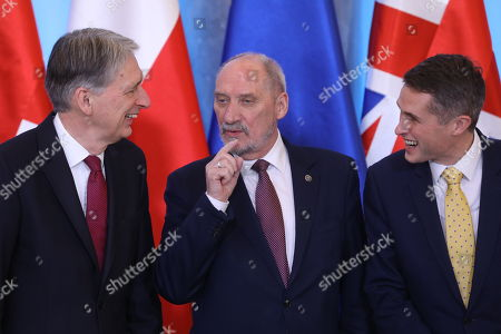 Polish Defense Minister Antoni Macierewicz (C), British Defence Minister Gavin Williamson (R) and British Finance Minister Philip Hammond (L) before the family photo at the Belvedere Palace in Warsaw, Poland, 21 December 2017. Polish Prime Minister Mateusz Morawiecki and Britain's Prime Minister Theresa May with delegations took part in the Polish-British intergovernmental consultations. May's visits comes in the wake of British former First Secretary of State, (Deputy Prime Minister), Damian Green being sacked from the cabinet after an inquiry found he had breached the ministerial code.