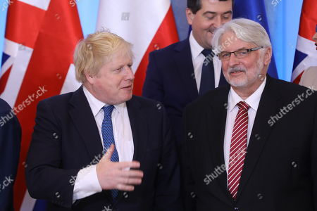 Polish Minister of Foreign Affairs Witold Waszczykowski (R) and British Foreign Minister Boris Johnson (L) before the family photo at the Belvedere Palace in Warsaw, Poland, 21 December 2017. Polish Prime Minister Mateusz Morawiecki and Britain's Prime Minister Theresa May with delegations took part in the Polish-British intergovernmental consultations. May's visits comes in the wake of British former First Secretary of State, (Deputy Prime Minister), Damian Green being sacked from the cabinet after an inquiry found he had breached the ministerial code.