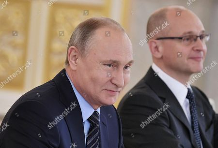 Russian President Vladimir Putin (L) and Russian First Deputy Chief of Staff of the Presidential Executive Office Sergei Kiriyenko (L) attend a meeting of the Council for Culture and Art in the Kremlin in Moscow, Russia, 21 December 2017.