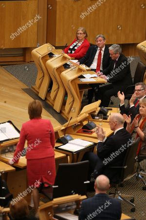 Elaine Smith, Richard Leonard, Leader of the Scottish Labour Party, and Iain Gray, listen to Nicola Sturgeon, First Minister of Scotland and Leader of the Scottish National Party (SNP)