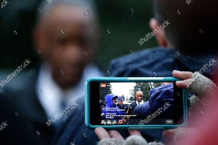 Stock Image of Washington State Patrol Chief John Batiste is filmed on a cell phone while speaking to media members near the scene of an Amtrak train crash onto Interstate 5, in DuPont, Wash