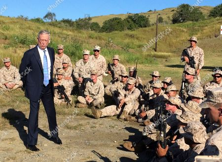 Defense Secretary Jim Mattis talks to U.S. Marine Corps troops at a rifle range at the Guantanamo Bay, Cuba, on Thursday, Dec. 21. 2017. The unannounced visit was the first by a defense secretary since Donald Rumsfeld visited in January 2002 shortly after the first prisoners arrived from Afghanistan