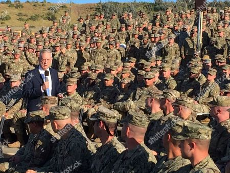 Defense Secretary Jim Mattis talks to troops at an outdoor movie theater at Guantanamo Bay, Cuba, on Thursday, Dec. 21. 2017. The unannounced visit was the first by a defense secretary since Donald Rumsfeld visited in January 2002 shortly after the first prisoners arrived from Afghanistan