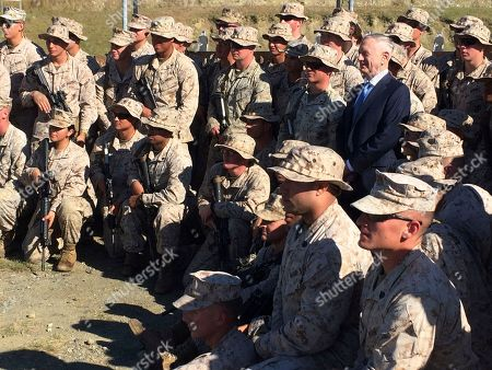 Defense Secretary Jim Mattis poses for a photo with U.S. Marine Corps troops at a rifle range at Guantanamo Bay, Cuba, on Thursday, Dec. 21. 2017. The unannounced visit was the first by a defense secretary since Donald Rumsfeld visited in January 2002 shortly after the first prisoners arrived from Afghanistan