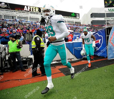 Miami Dolphins tight end Julius Thomas (89) runs on to the field before an NFL football game against the Buffalo Bills, in Orchard Park, N.Y