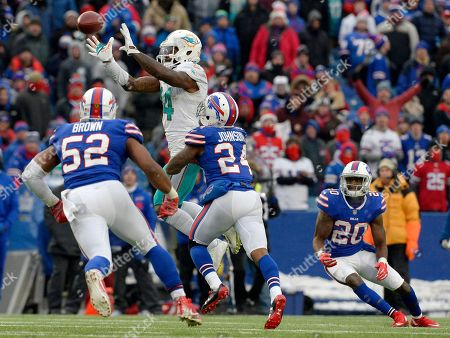 Miami Dolphins wide receiver Jarvis Landry (14) jumps for a catch among Buffalo Bills defenders linebacker Preston Brown (52), cornerback Leonard Johnson (24) and cornerback Shareece Wright (20) during the second half of an NFL football game, in Orchard Park, N.Y. Buffalo beat Miami 24-16