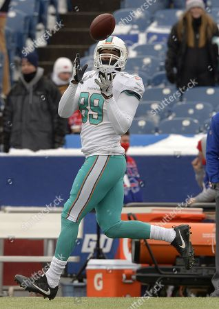 Miami Dolphins tight end Julius Thomas (89) warms up before an NFL football game against the Buffalo Bills, in Orchard Park, N.Y