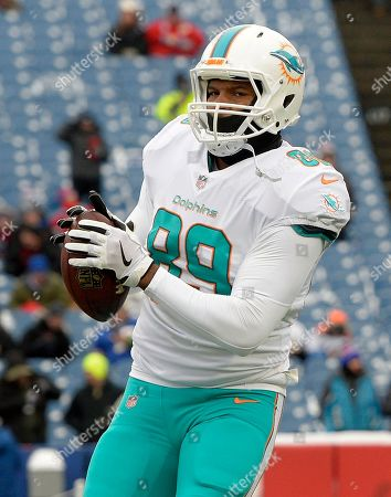 Stock Picture of Miami Dolphins tight end Julius Thomas (89) warms up before an NFL football game against the Buffalo Bills, in Orchard Park, N.Y