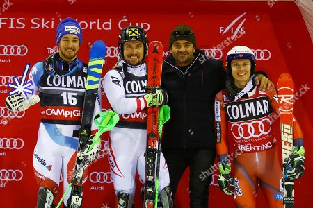 First placed Austria's Marcel Hirscher, center, second placed Switzerland's Luca Areni, left, and third placed Norway's Henrik Kristoffersen, right, celebrate on the podium with Alberto Tomba at the end of a Men's Ski World Cup Slalom, in Madonna di Campiglio, Italy
