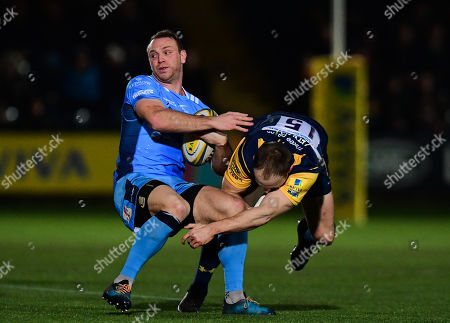 Greig Tonks of London Irish is tackled by Chris Pennell of Worcester Warriors