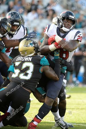 Alfred Blue, Blair Brown. Houston Texans running back Alfred Blue (28) is tackled by Jacksonville Jaguars linebacker Blair Brown (53) after rushing for yardage during the second half of an NFL football game, in Jacksonville, Fla. The Jaguars won 45-7