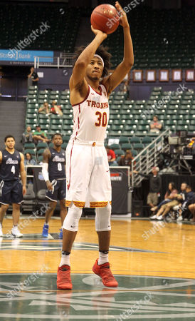 USC Trojans guard Elijah Stewart (30) shoots a free throw during game between USC Trojans and the Akron Zips at the Hawaiian Airlines Diamond Head Classic at the Stan Sheriff Center on the campus of the University of Hawaii in Honolulu, Hawaii - Michael Sullivan/CSM