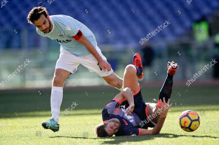 Lazio's Marco Parolo, left, and Crotone's Marcus Rohden fight for the ball during an Italian Serie A soccer match between Lazio and Crotone, in Rome's Olympic stadium