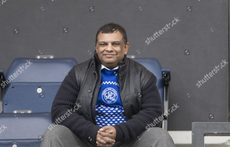Queens Park Rangers owner Tony Fernandes in his Christmas jumper sits in the stand