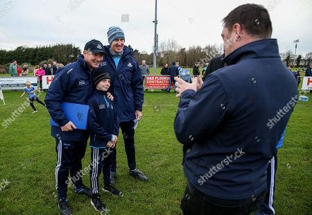 Dublin vs Dub Stars. Dublin's manager Jim Gavin and coach Paul Clarke pose for a photo with a young fan