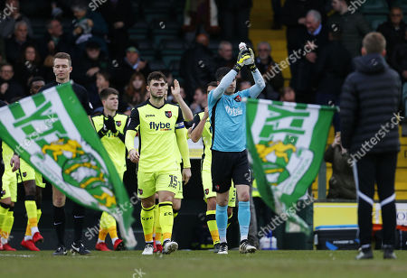 Jordan Moore-Taylor, Captain of Exeter City and Christy Pym, Goalkeeper of Exeter City walk out during the Sky Bet League 2 match between Yeovil Town and Exeter City, at Huish Park, Yeovil, Somerset, on December 23rd 2017,