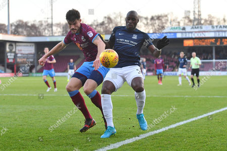 Southend United forward Marc-Antoine Fortune (9) and Scunthorpe United defender Cameron Burgess (21)during the EFL Sky Bet League 1 match between Scunthorpe United and Southend United at Glanford Park, Scunthorpe