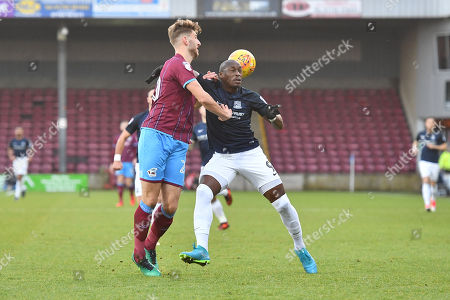 Southend United forward Marc-Antoine Fortune (9) and Scunthorpe United defender Charlie Goode (20) during the EFL Sky Bet League 1 match between Scunthorpe United and Southend United at Glanford Park, Scunthorpe